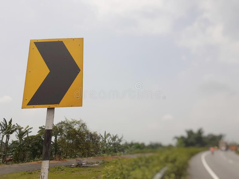 Curve right side traffic road sign on highway royalty free stock photos