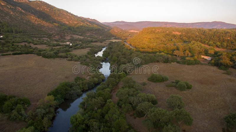 Curve of the river with canyon at the sunset seen from above with the drone royalty free stock photography