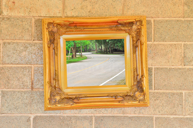 Curve road in Vintage picture frame stock images