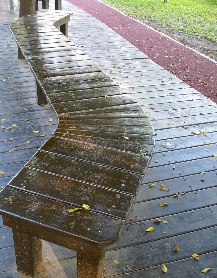 The curved bench. Located on school playground stock images
