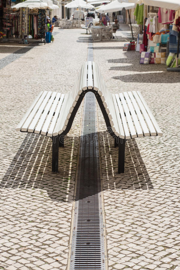 Curved bench in Portugal, Vila Real de Santo Antonio. And stalls royalty free stock photo