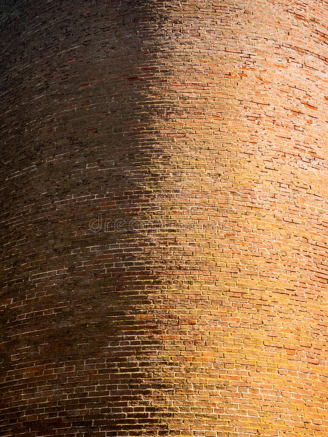 Curved, Red Brick Wall Detail on Lighthouse stock image