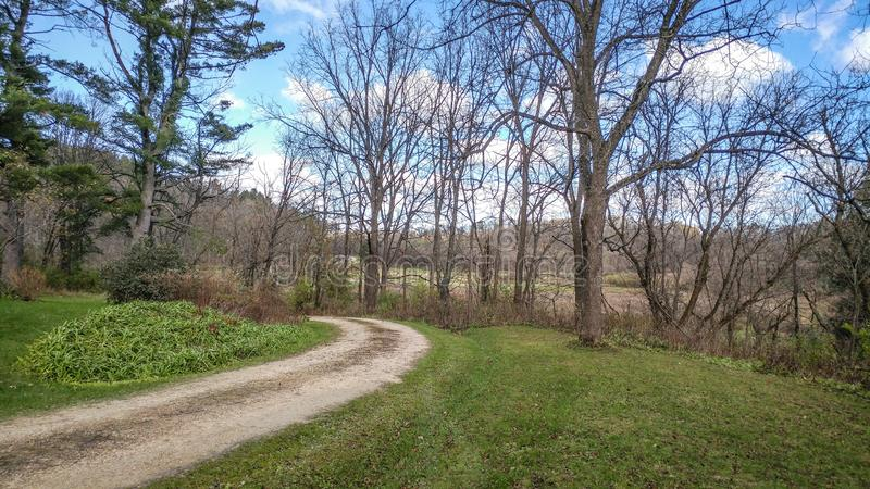Curved Gravel Road through Woods royalty free stock photography