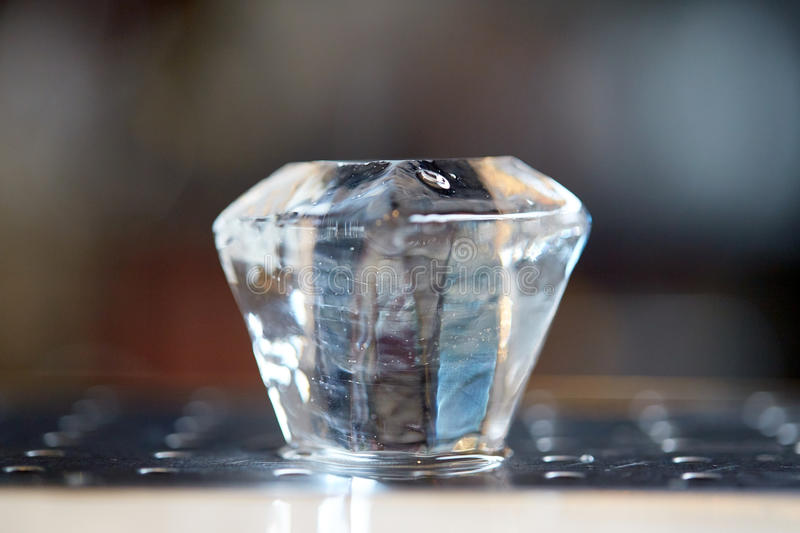 Curved ice cube at bar. Bartending concept - diamond shape curved ice cube at bar stock photo