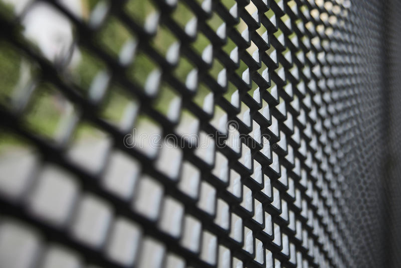 Curved metal fence stock image