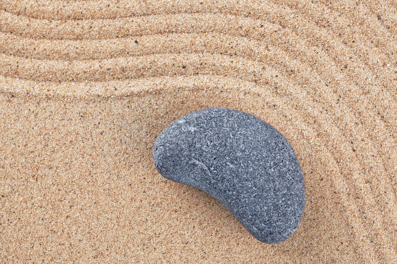 Curved Pebble On Raked Sand Royalty Free Stock Photography