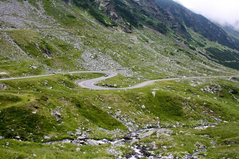 Curved road. From Transfagarasan valley stock photos