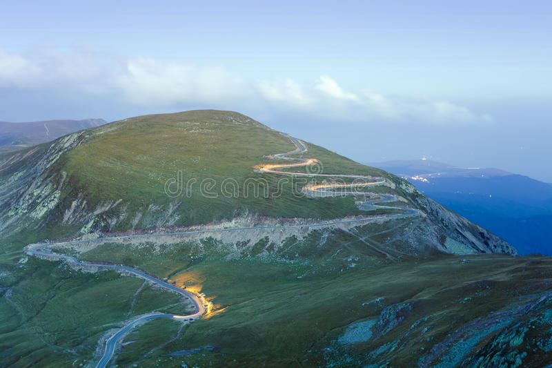 Curved road in mountains of Parang, Romania royalty free stock photography