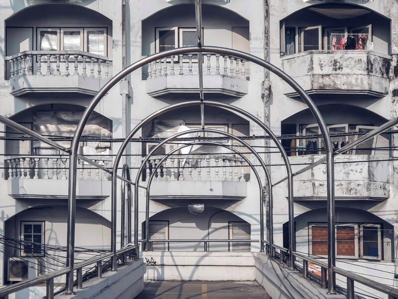 The curved roof structure made of stainless steel was installed on a pedestrian overpass royalty free stock image