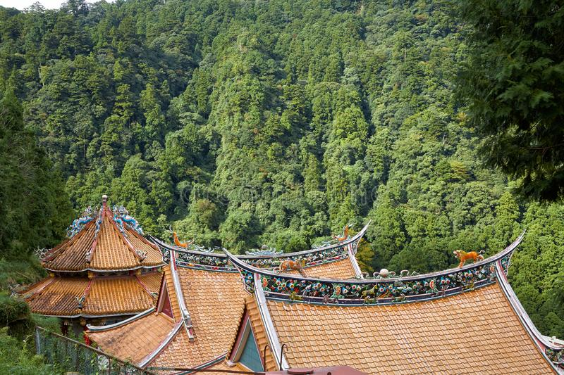 The colorfully decorated curved tile roofs of the abandoned  Chinese temple. Wakayama. Japan. The curved roofs decorated with ornamental dragons at the abandoned stock image