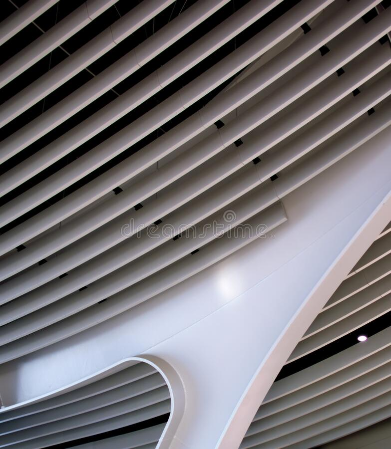 Curved structural column at an airport. Modern architecture. stock photography