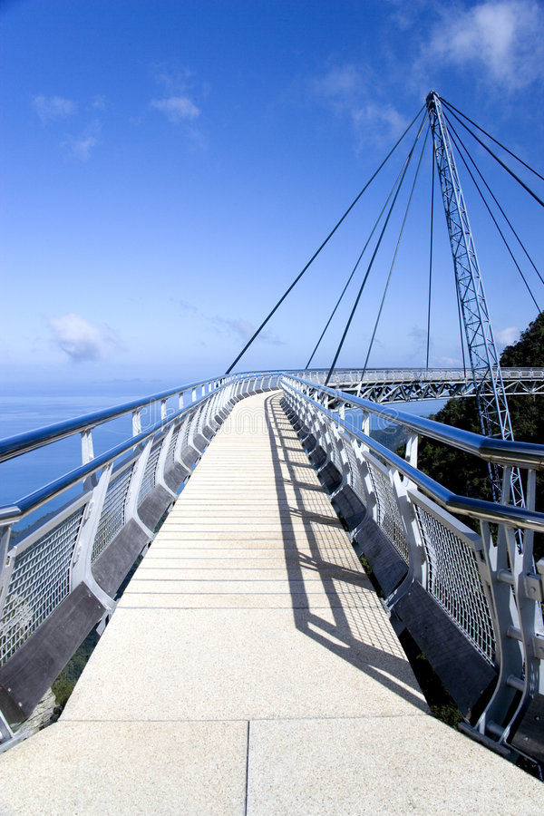 Download Curved Suspension Bridge stock photo. Image of leaves - 1557078