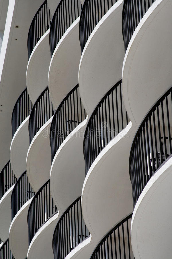 Curved white hotel balconies royalty free stock photo