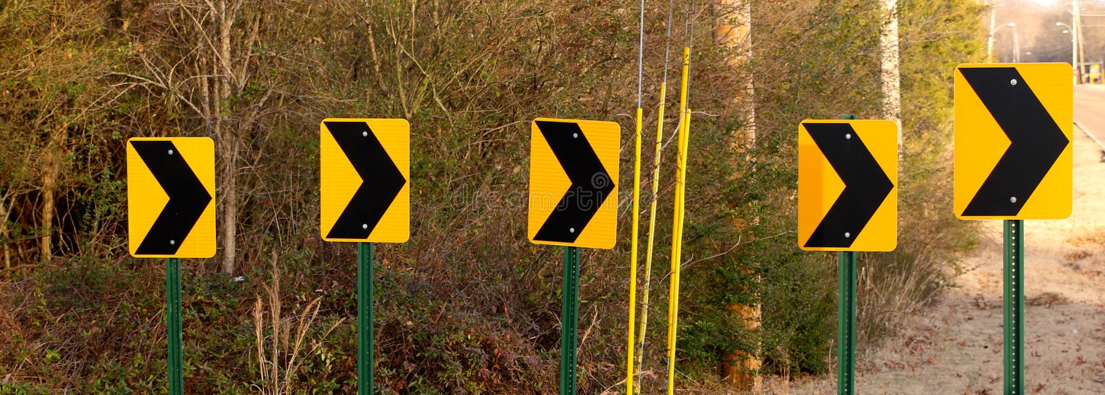 Curves Ahead Street Signs. Street signs warn of a winding curvy bend in the road ahead stock photography