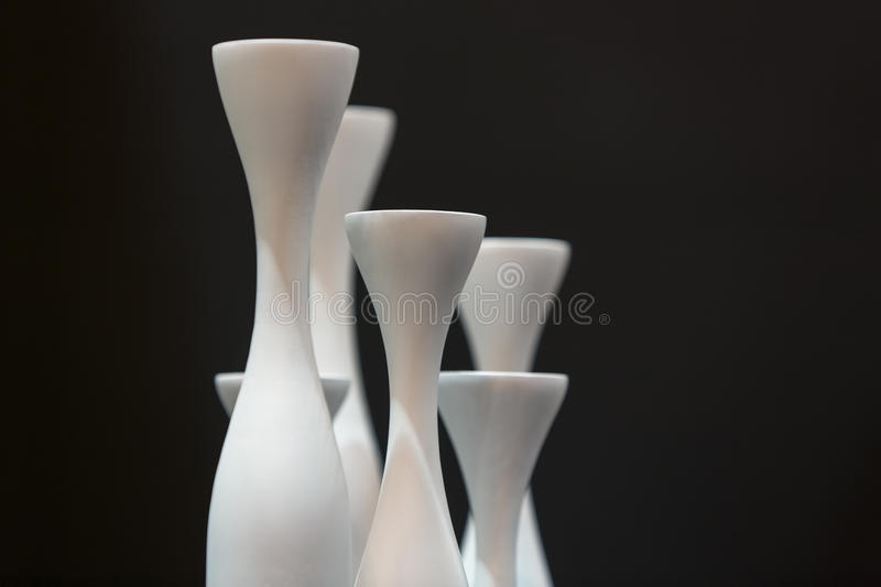 Curves of empty vases in black and white. Abstract and black and white of curves of empty vases on a dining table royalty free stock photo