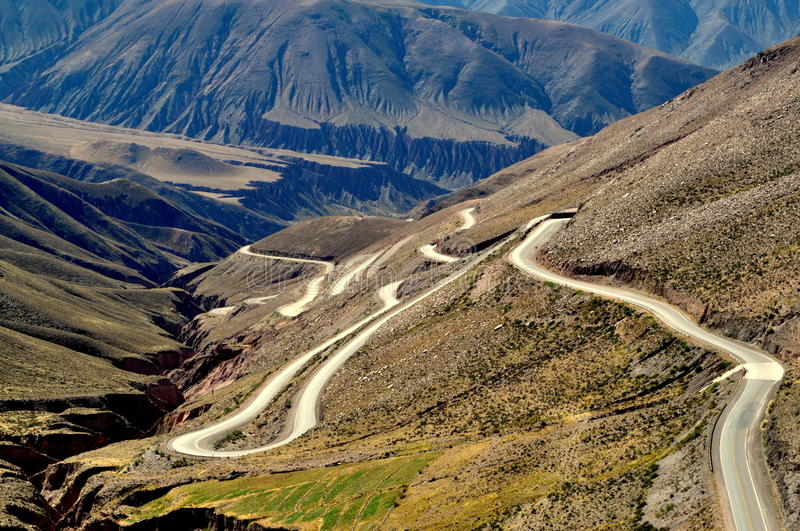Curves at the mountain. A road with curves at a mountain royalty free stock photos
