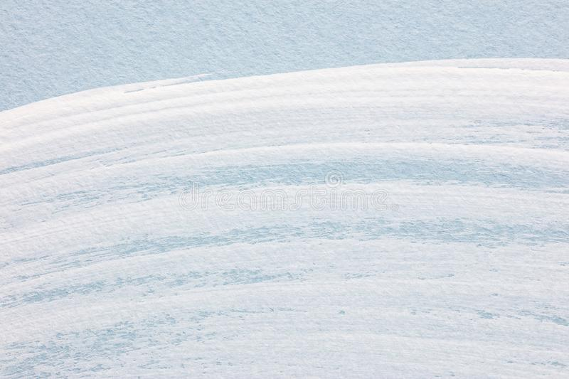 Curves white brush strokes on light blue paper. hand painted background royalty free stock photo