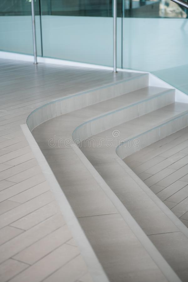 Curvilinear stairs. Top view of modern architecture detail. Refined fragment of contemporary office interior, public stock images