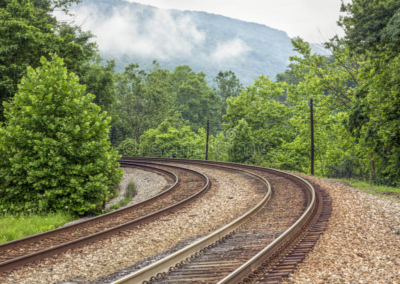 Curving Double Railroad Tracks royalty free stock photo
