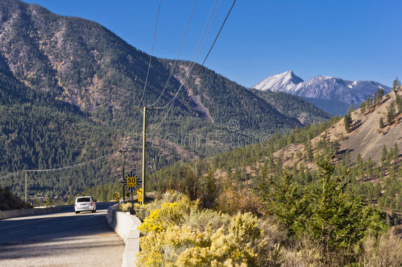 Curving highway and mountains stock photo