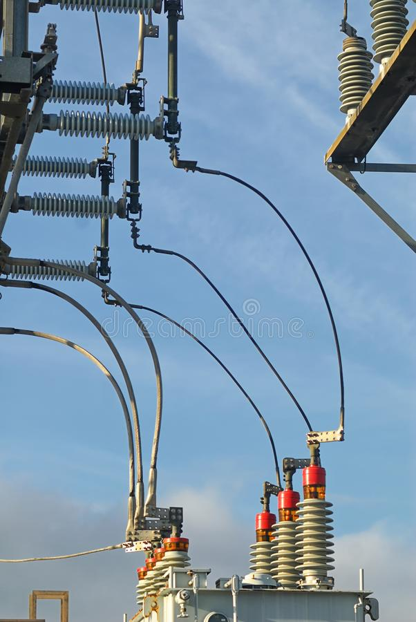 Curving power lines from transmission to distribution in a sub station. royalty free stock images