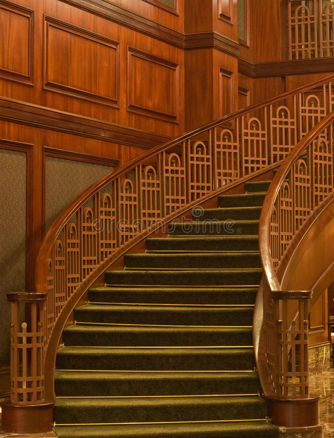 Free Curving Staircase With Green Carpet Stock Photos - 14138453