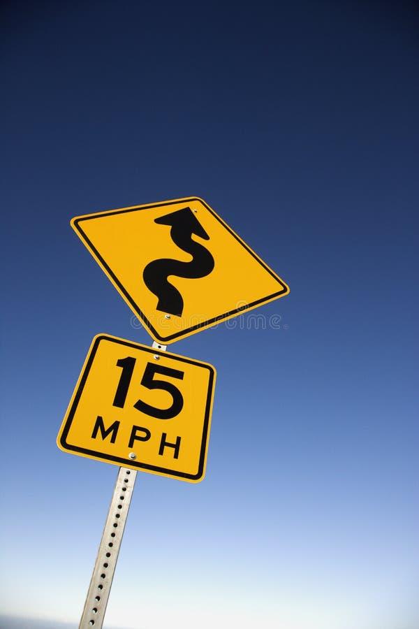 curvy предупреждение дорожного знака стоковая фотография