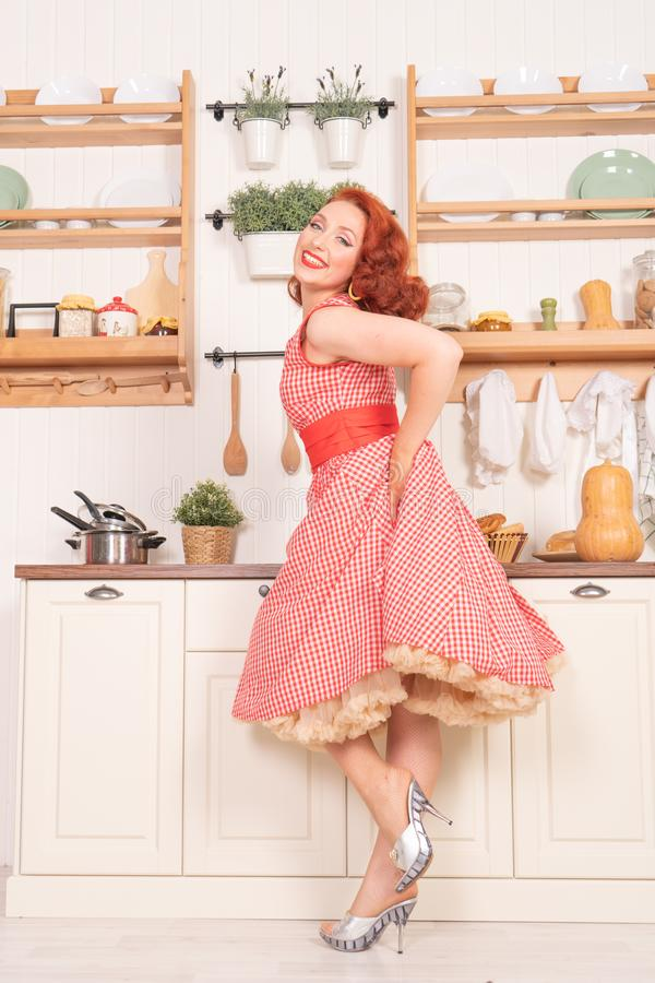 Curvy chubby adult woman posing naked in transparent cute dresses alone on pink studio backgroundbeautiful red-haired pinup s stock images