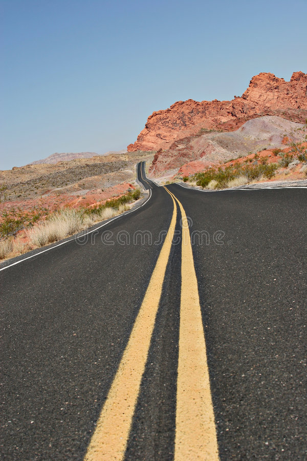 Curvy desert road royalty free stock photos