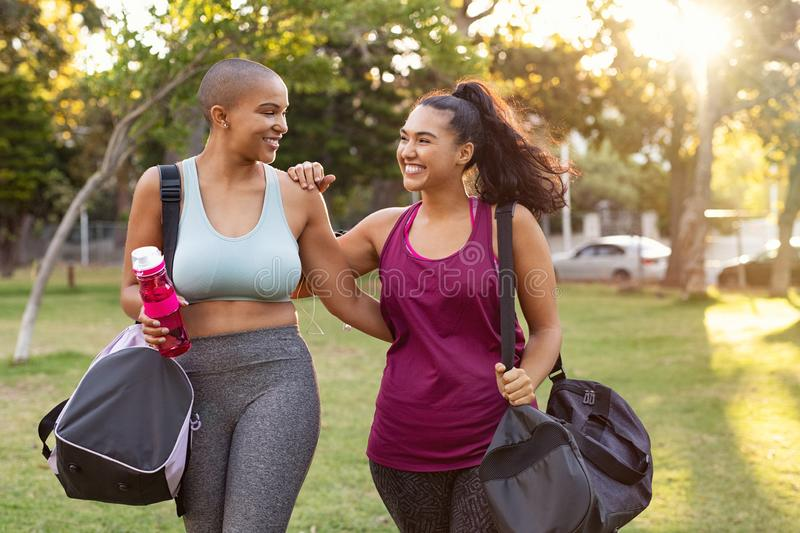 Curvy friends walking home after fitness exercise royalty free stock images