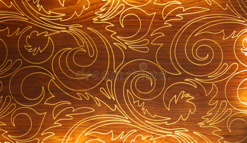 Curvy pattern on wood. Elegant pattern of curves painted onto timber royalty free stock images