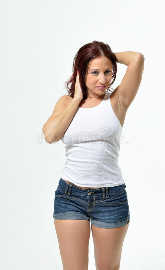 Curvy Redheaded Woman In Tank Top And Shorts Stock Image - Image of lady tanktop 39001579