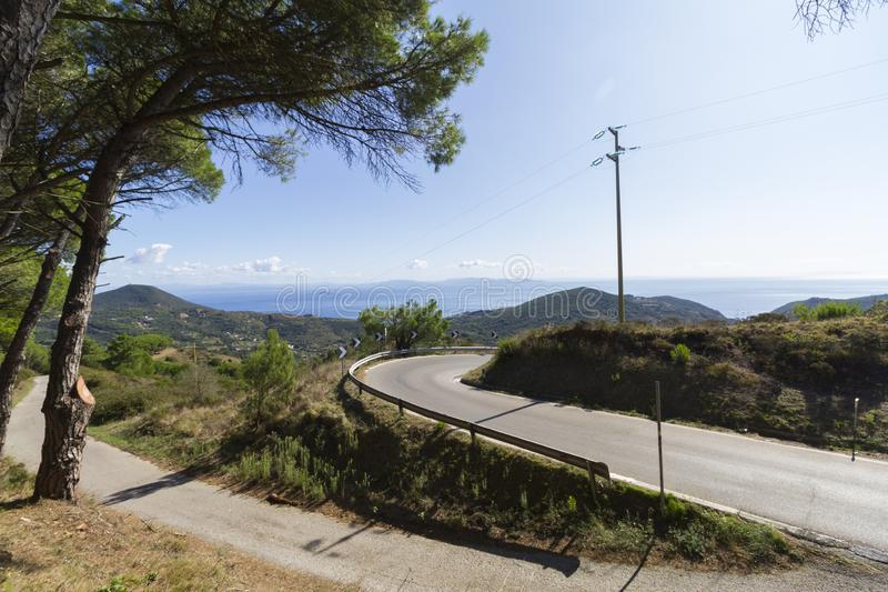 Curvy road in Tuscan, with see view. And blue sky stock photo