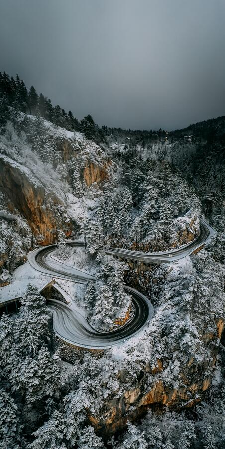Free Curvy Windy Mountain Road In Snow Covered Forest, Top Down Aerial View. Winter Landscape Stock Photography - 170100582
