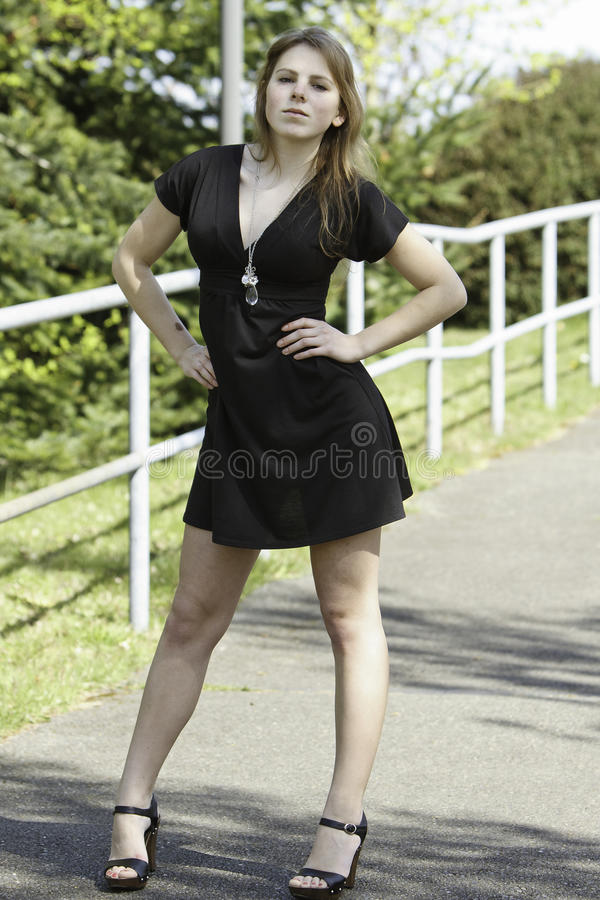 Curvy young and fashionable youthful woman posing. royalty free stock image