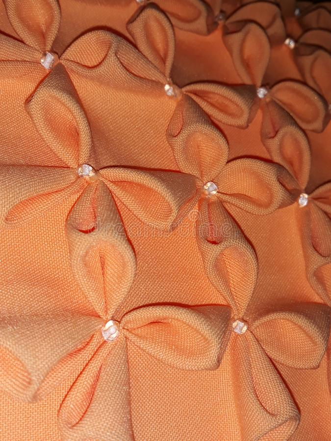 Cuscino arancio impresso immagini stock