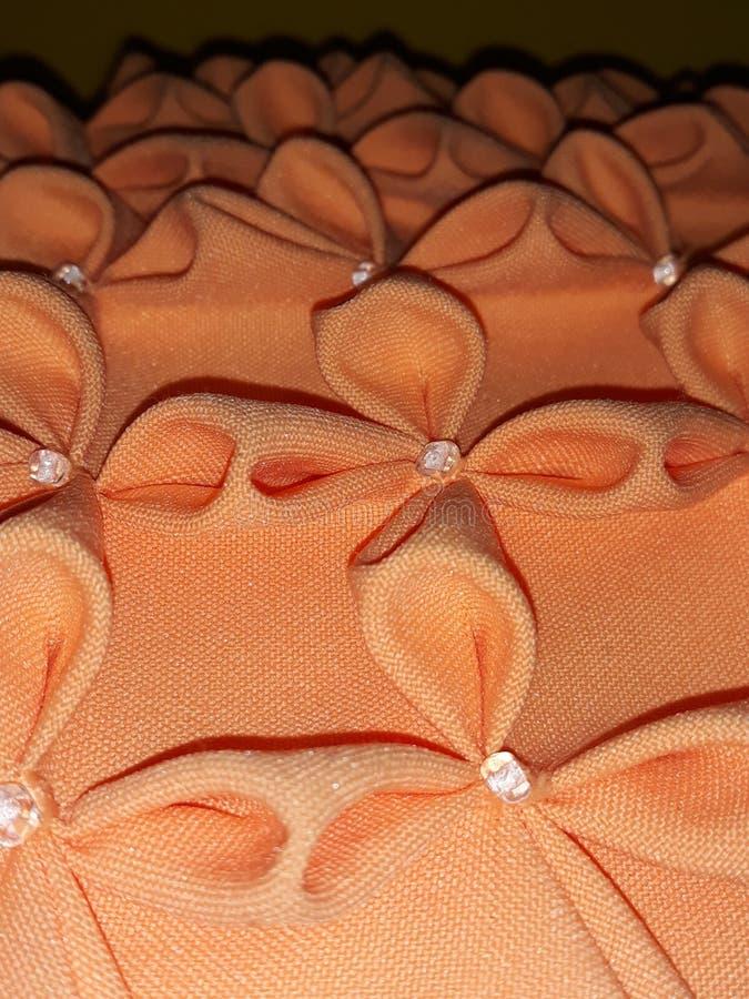 Cuscino arancio impresso immagine stock