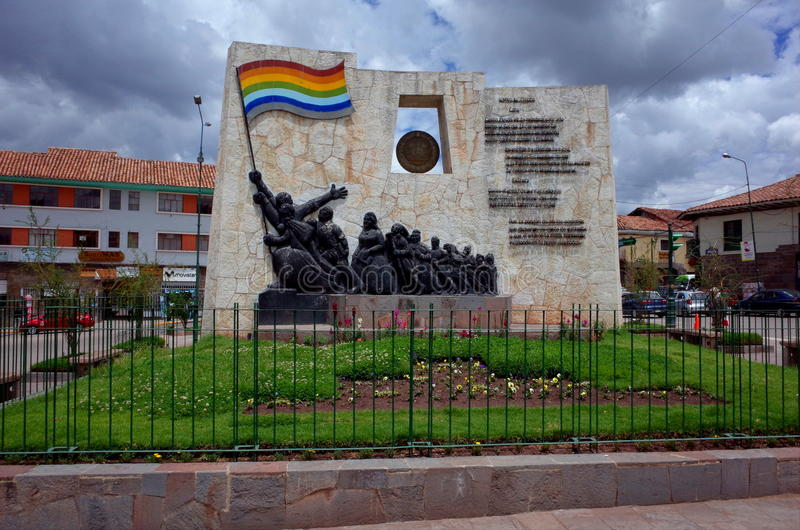 The Cusco Anthem. A monument in Cusco with the words of the Cusco anthem. The flag of Cuzco can also be seen royalty free stock image