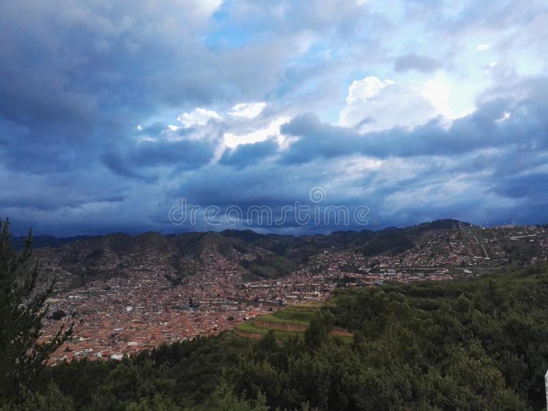 Cusco. Magic clouds stock image