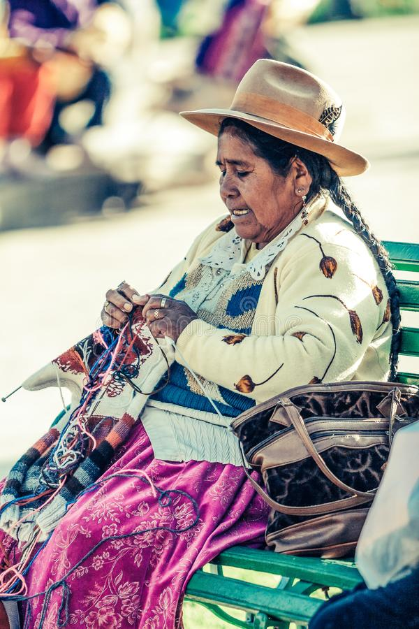 Cusco / Peru - May 26.2008: Portrait of a  indigenous woman, dressed up in traditional native peruvian clothes royalty free stock photo
