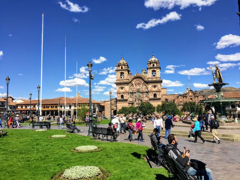 Many tourists admire the view of Plaza de Armas in beautiful and ancient Cusco, Peru. stock images