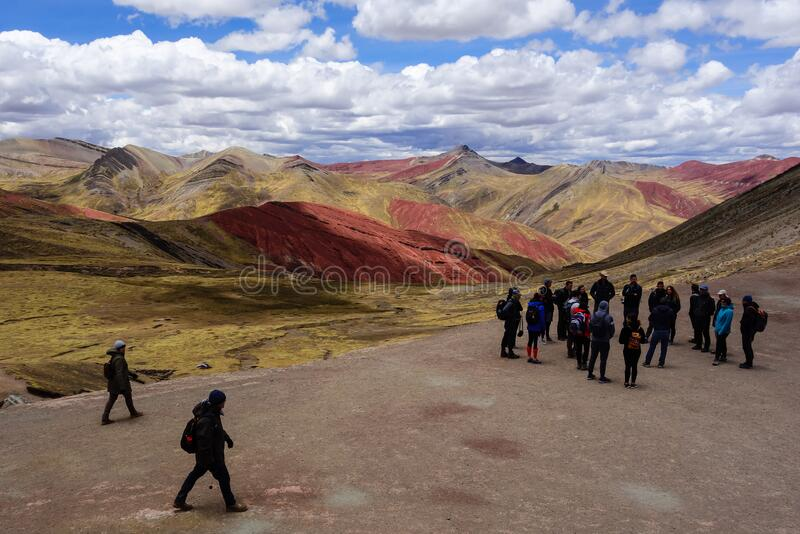 Cusco/Peru - Oct.03.19: group of tourists on the Palccoyo rainbow mountains royalty free stock photo