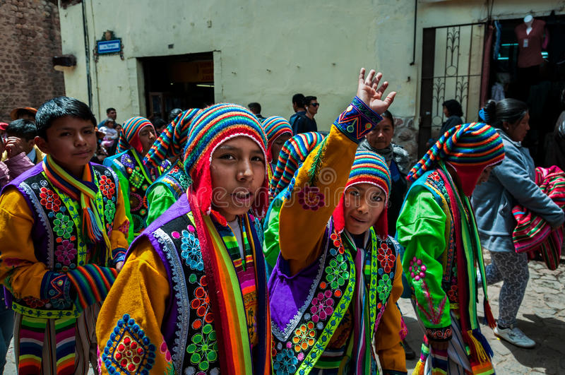 CUSCO, PERU - OCTOBER 7, 2016: Peruvian boys wearing traditional clothes take part in a festive procession. stock photo