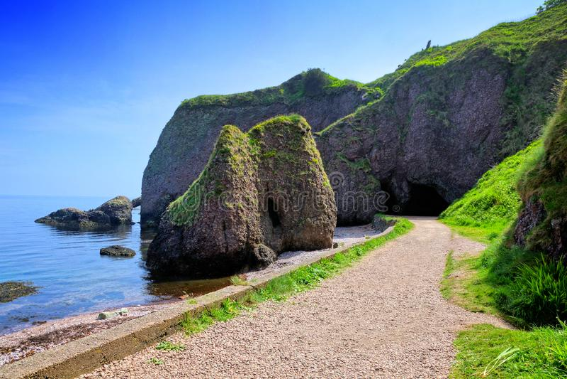 Cushendun caves, Causeway Coast, Antrim, Northern Ireland royalty free stock images