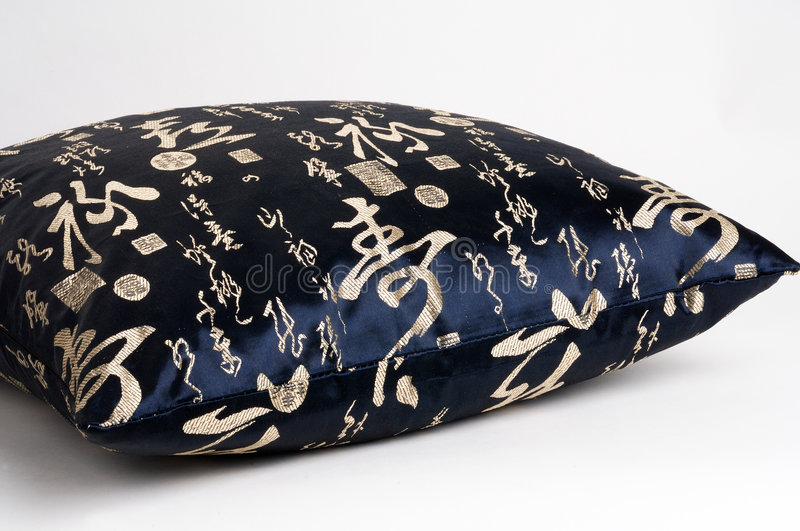 Cushion with chinese characters writing royalty free stock images