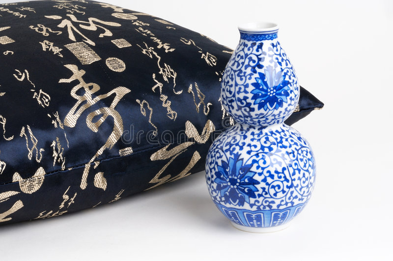 Download Cushion With Chinese Characters Writing And Blue Ceramic Vase Stock Photo - Image of writing, chinese: 502958