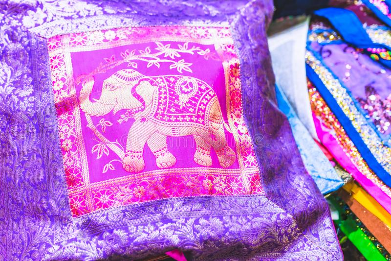 Cushion with entini designs. Embroidered pillow with elephant of an oriental stall royalty free stock photography