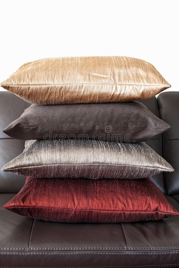 Cushions on leather sofa royalty free stock images