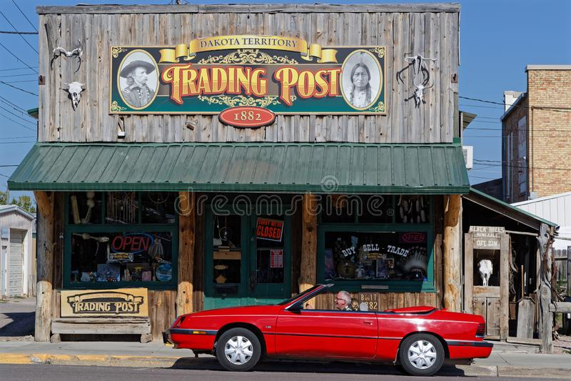 Red Car and the Trading Post in Custer. CUSTER, SOUTH DAKOTA, September 16, 2018 : red car and old Trading Post in Custer. A trading post was an establishment stock images