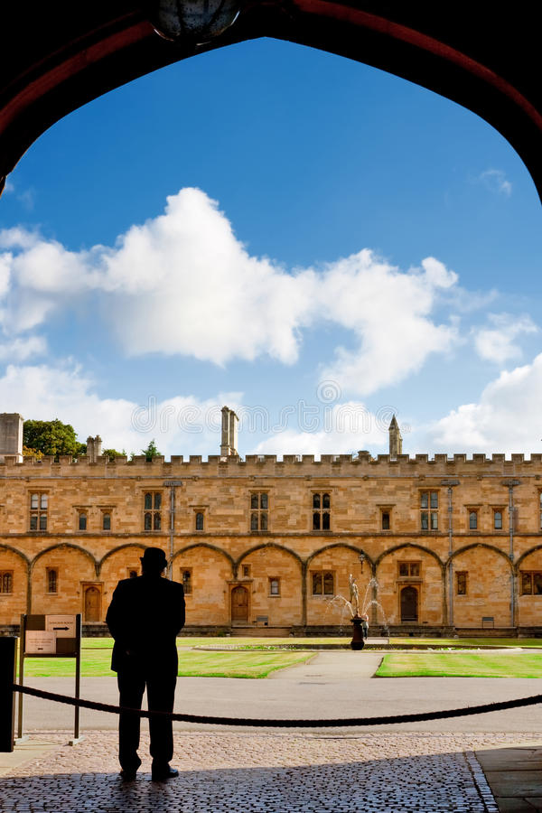 Custodian in archway. Oxford, UK royalty free stock photo